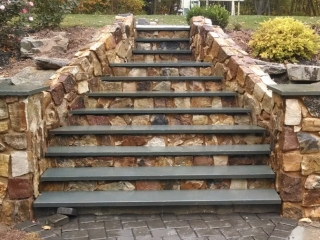 outdoor stone steps after construction in backyard