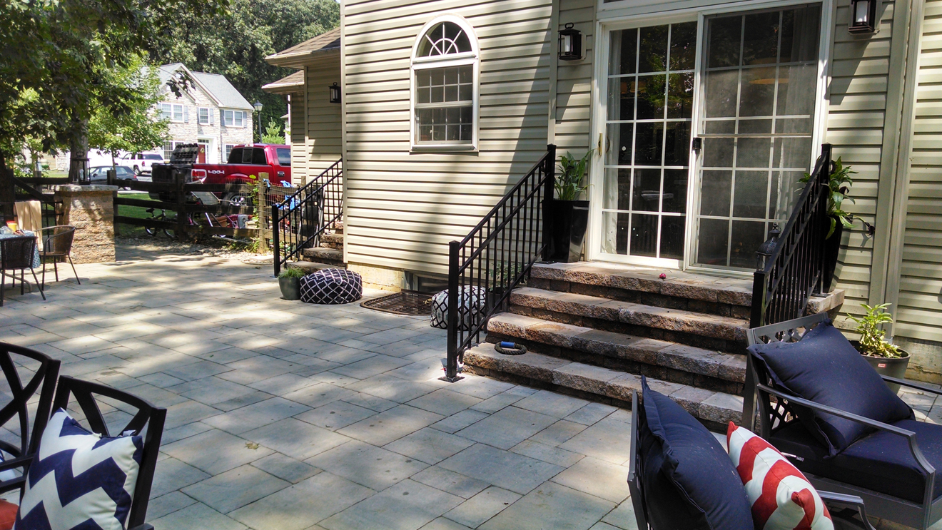 closeup of patio paver detail and stone steps leading to back door