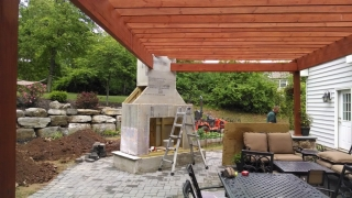 frame of outdoor fireplace attached to outdoor roof