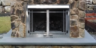 closeup of outdoor stone fireplace