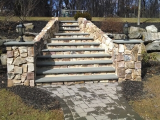 ornate outdoor stone steps with landscape lighting