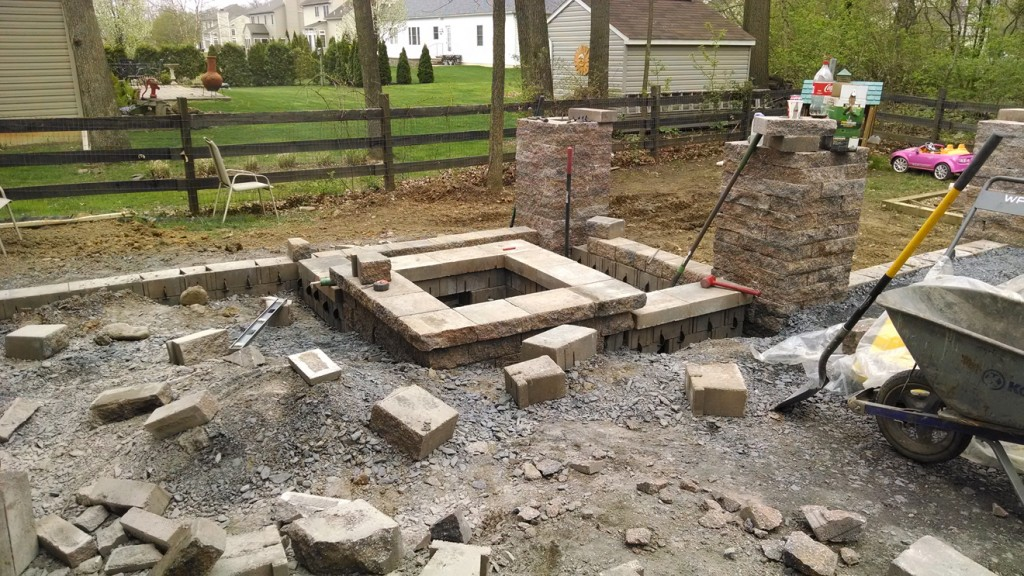 custom square fire pit in beginning stage of construction