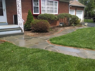 front lawn stone walkway with custom stonework