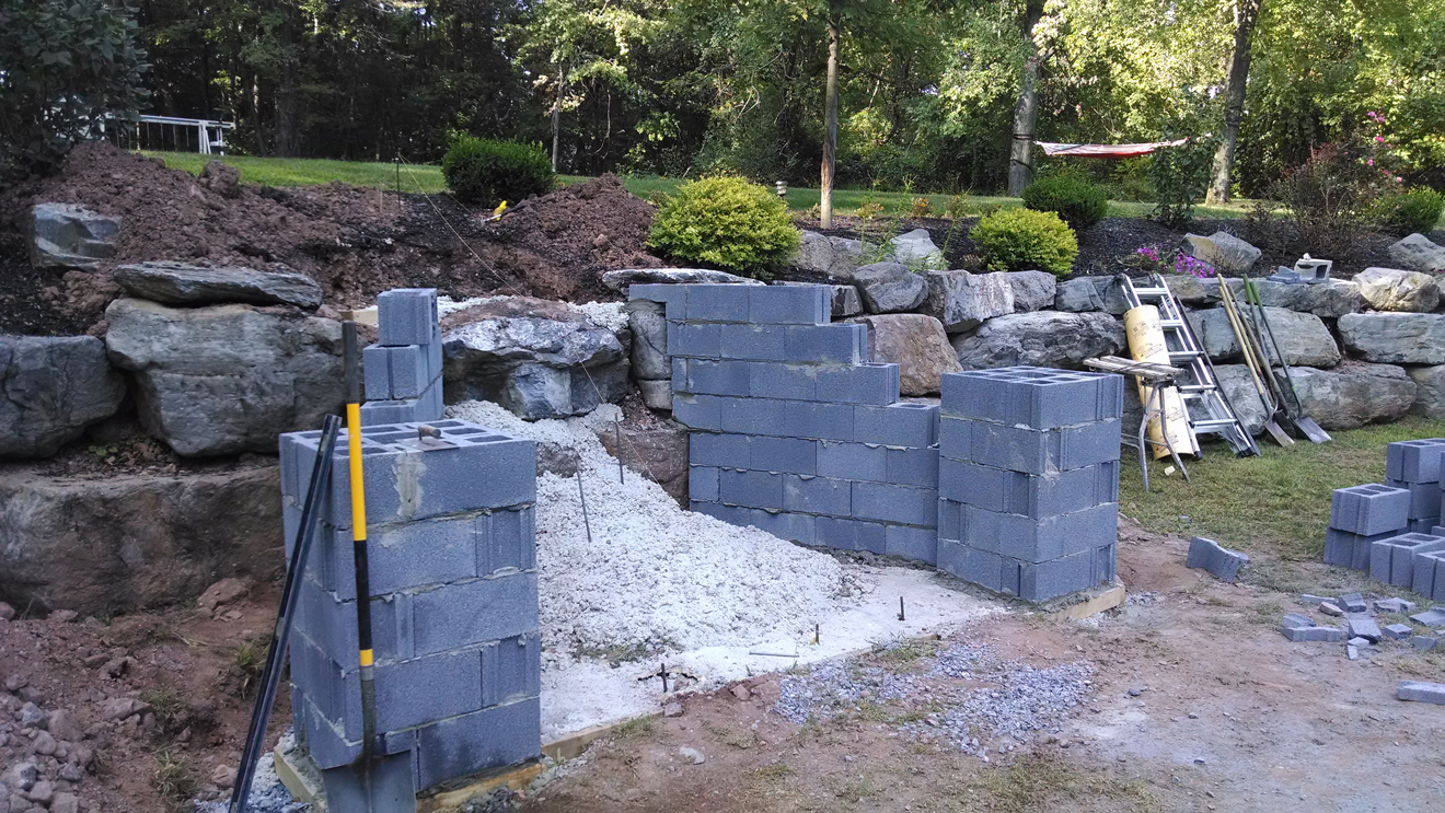 concrete block foundation for stone staircase
