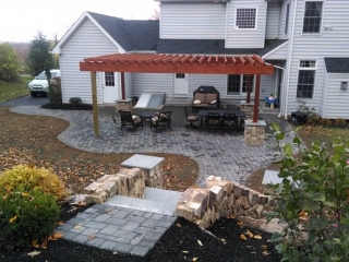 backyard patio with slatted wood awning
