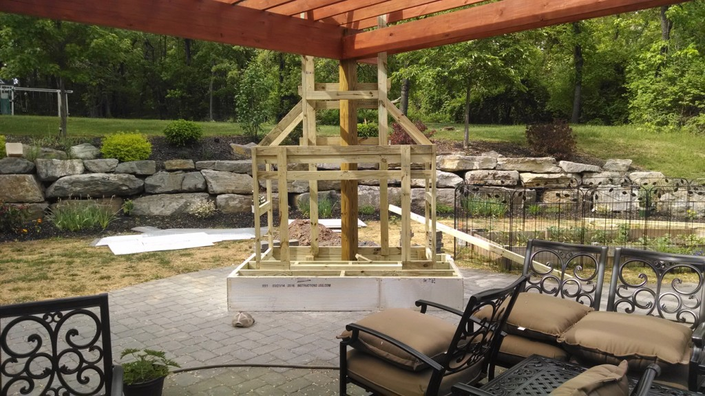wood frame of outdoor fireplace attached to outdoor roof